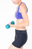 Pretty woman in sportswear lifting dumbbell Stock Photos
