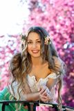 Pretty woman among a spring blossom Stock Photos