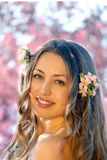 Pretty woman among a spring blossom Royalty Free Stock Image