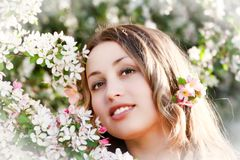 Pretty woman among a spring blossom Royalty Free Stock Photo