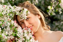 Pretty woman among a spring blossom Stock Photo