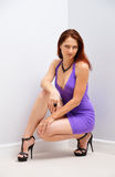 Pretty woman squatting Stock Photos