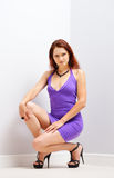 Pretty woman squatting Stock Image