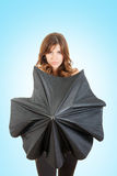 Pretty woman standing behind an umbrella. Hiding her bust , Girl opening black umbrella in front of her Royalty Free Stock Photo
