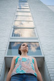 Pretty woman standing in front of a tall building Royalty Free Stock Photos
