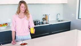 Pretty woman standing having healthy breakfast stock footage