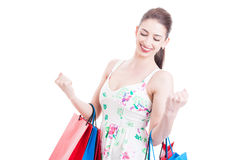 Pretty woman standing and holding shopping bags as feeling stron Royalty Free Stock Photos