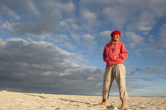 Pretty woman standing lonely at beach Royalty Free Stock Photo