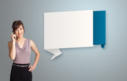 Pretty woman standing next to modern origami copy space and maki Royalty Free Stock Image