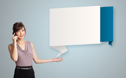 Pretty woman standing next to modern origami copy space and maki Stock Photography