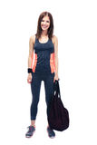 Pretty woman standing with sports bag Royalty Free Stock Images