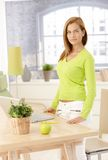 Pretty woman standing at table Royalty Free Stock Photos