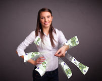 Pretty woman standing and throwing money Stock Photos