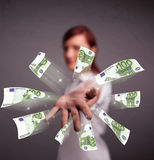 Pretty woman standing and throwing money Royalty Free Stock Images