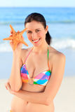 Pretty woman with a starfish Royalty Free Stock Photography