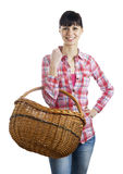 Pretty woman and wicker basket Royalty Free Stock Photos