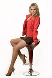 Pretty woman on stool Royalty Free Stock Photography