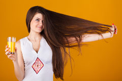 Pretty woman with straight hair and juice oranges Royalty Free Stock Photo