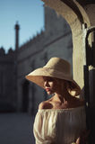 Pretty woman in straw hat Stock Image