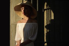 Pretty woman in straw hat Stock Photo