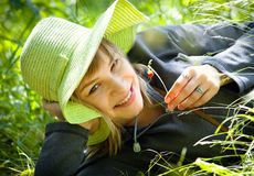Pretty woman with strawberry. Beautiful young woman relaxing in the grass with strawberry stock photo