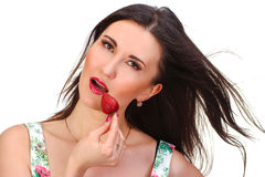 Pretty woman with strawberry in hand isolated on white Stock Images