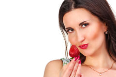 Pretty woman with strawberry in hand isolated on white Stock Image