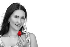 Pretty woman with strawberry in hand isolated on white Royalty Free Stock Photo