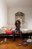 Pretty woman stretching in her bed Royalty Free Stock Photos