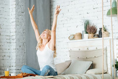 Pretty woman stretching herself in the morning Stock Photography