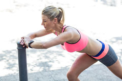 Pretty woman stretching herself on pipe Stock Image