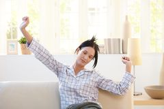 Pretty woman stretching in pyjama Stock Image