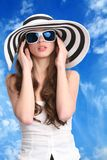 Pretty woman in striped hat Stock Images