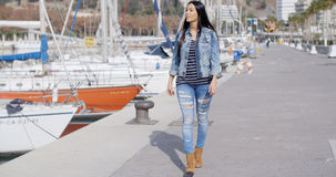 Pretty woman strolling on a waterfront promenade Stock Photography