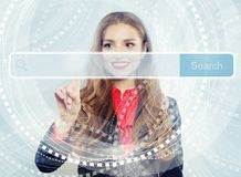 Pretty woman student smiling and pointing to empty address bar in virtual web browser. Distance learning and advertising marketing. Concept royalty free stock photo