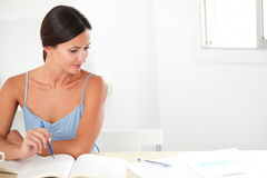 Pretty woman studying her books at home Royalty Free Stock Image