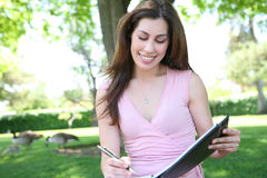 Pretty Woman Studying Under Tree Stock Photos