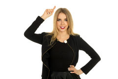 Pretty woman in stylish black clothes posing Royalty Free Stock Photo