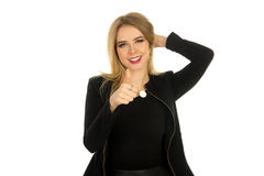 Pretty woman in stylish black clothes posing. A charming young blonde girl in stylish black clothes with red lips posing and smiling in studio on white Stock Images