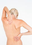 Pretty woman suffering from back pain Royalty Free Stock Images