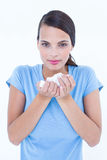 Pretty woman suffering from cold holding tissue Stock Photos
