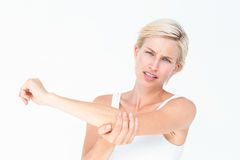 Pretty woman suffering from elbow pain Stock Photo