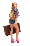 Pretty woman with suitcase Stock Photography