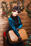 Pretty woman with  suitcase in christmas interior Stock Images