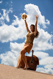Pretty woman with suitcase and guitar Stock Photo