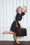 Pretty woman with a suitcase in his hand Royalty Free Stock Image