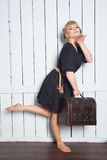Pretty woman with a suitcase in his hand Stock Images