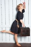 Pretty woman with a suitcase in his hand Royalty Free Stock Photography