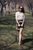 Pretty woman in summer dress outdoors Stock Photography