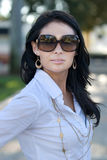 Pretty woman with sun glasses on. Stock Photo